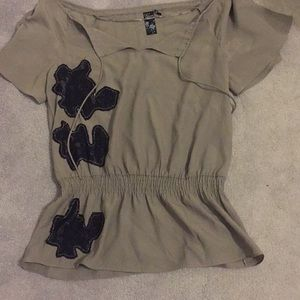 Grey blouse with black patches